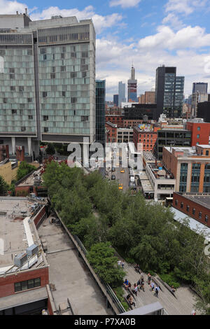 View of the High Line, an elevated linear park and rail trail that was developed on 1.4 miles of old freight line, as it goes under the Standard Hotel. - Stock Photo