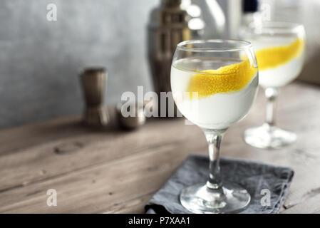 Vesper Martini Cocktail with lemon wedge. Homemade Vesper Cocktail on table, copy space. - Stock Photo
