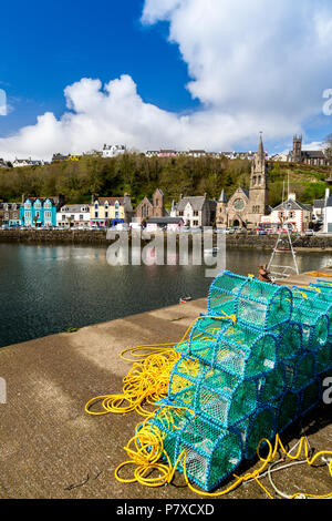 A stack of colourful new lobster creels on the harbour wall in Tobermory, Isle of Mull, Argyll and Bute, Scotland, UK - Stock Photo