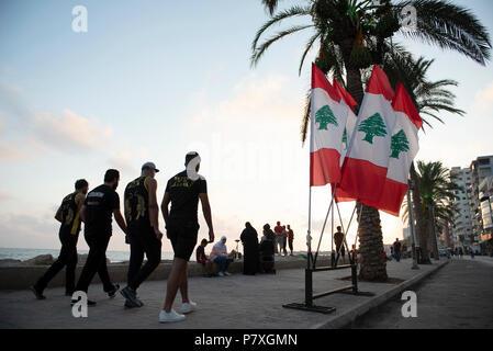 Basket ball team walking on the beach in Tyre Lebanon. - Stock Photo