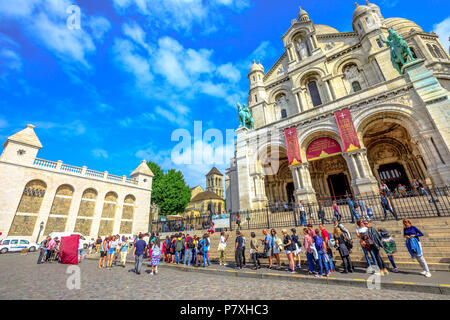 Paris, France - July 3, 2017: perspective view of people in front of Basilique du Sacre Coeur de Montmartre. Sacred Heart Church is a popular attraction and landmark in Paris. Sunny day blue sky. - Stock Photo