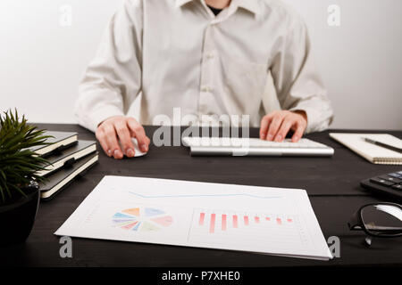 Close up of man accountant or banker making calculations. Savings, finances and economy concept - Stock Photo
