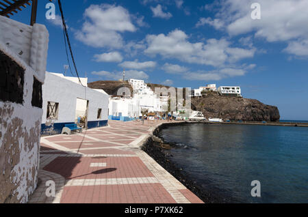 Las Playitas, Fuerteventura, Canary Islands, Spain: May 17, 2018: The view of a deserted old town in Las Playitas resort with  a beachfront promeande  - Stock Photo