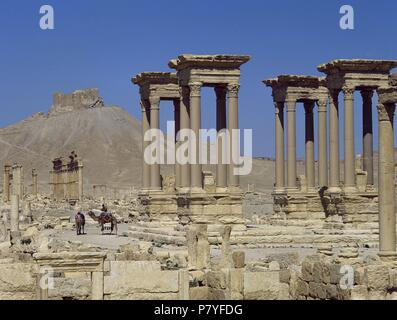 Syria. Palmyra. Tetrapylon. Marked the second pivot in the route of the colonnaded street.  Platform with columns. Roman monument. (destroyed in 2017 . Syrian Civil War). - Stock Photo