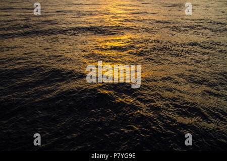 Advertising, Travel, Vacation and Holiday Concept - Sunsets lights reflections on the waves - Stock Photo