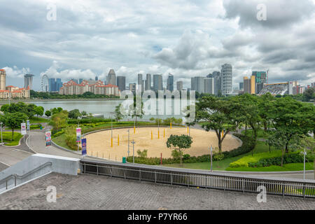 Singapore - July 3, 2018: View over the river towards downtown old and new Singapore - Stock Photo