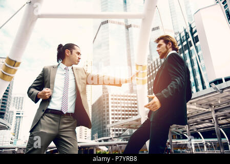 Angry businessmen push competitor from market share in imagine. Business marketing and Teamwork idea concept. Soft and split cross processing tone pin - Stock Photo