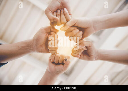 Fist Bump of friendship and teamwork for startup new project. Business and togetherness concept. Cooperation and Successful concept. People and hands  - Stock Photo