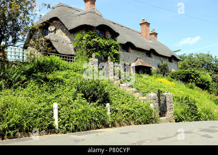 Godshill, Isle of Wight, UK. June 21, 2018.  The beautiful grade 11 listed thatch Church hill cottage taken from church hill at Godshill on the Isle o - Stock Photo