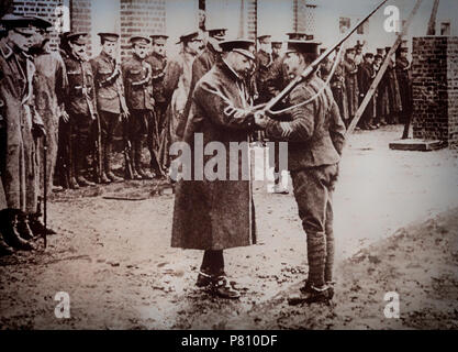 With the outbreak of World War 1, King George V crossed to France in November 1914 and spent several days with the troops. He decorated a soldier in the presence of Sir Douglas Haig, commander of the 1st Army Corps. - Stock Photo