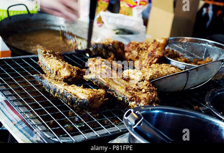 Pork was placed on the mesh - Stock Photo