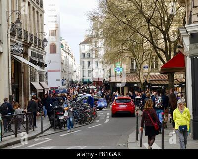 People crowd the Marais on rue de la Verrerie, on a Saturday evening in early April, Paris, France. - Stock Photo