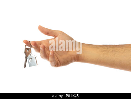 Male hand holding a house key isolated on white background, clipping path - Stock Photo
