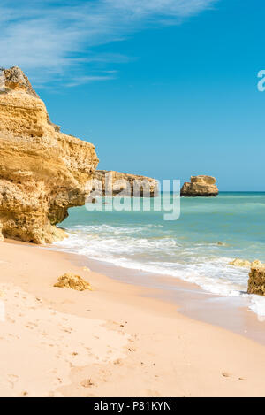 Beautiful sandy beaches, turquoise ocean and blue sky - Stock Photo