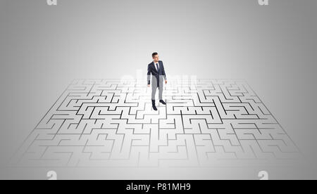 Elegant businessman looking for a solution in a middle of a maze   - Stock Photo