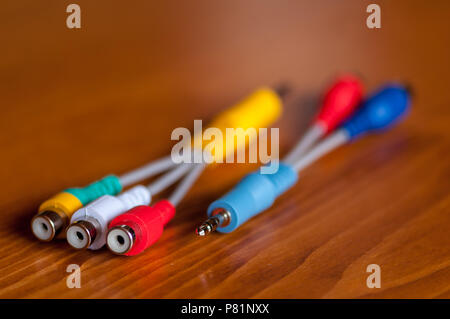 Close-up of a jack cord on a wooden table. - Stock Photo