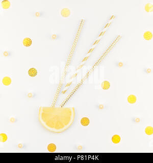Square flatlay overhead top view citrus lemon slices and candies white table background with copyspace. Hot summer refreshment lemonade concept. Bever - Stock Photo