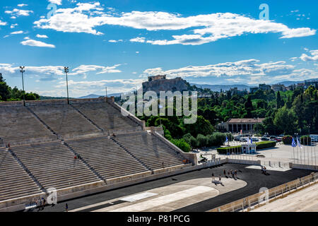 Panathenaic stadium with acropolis view, with clouds in the sky, Athens, Greece - Stock Photo