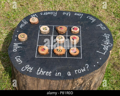 Childrens large wildlife themed wooden outdoor tic tac toe game (noughts and crosses). - Stock Photo