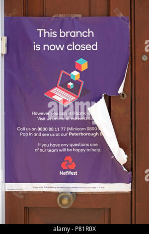 Sign on doorway of closed down National Westminster Bank (Nat West Bank) Stamford High Street Branch, Lincolnshire, England, UK - Stock Photo