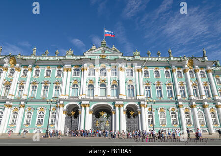 Tourists queuing to enter the Winter Palace and State Hermitage Museum in St Petersburg - Stock Photo