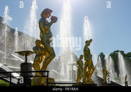 Golden statues of the Grand Cascade of the Peterhof Palace in St Petersburg, Russia - Stock Photo