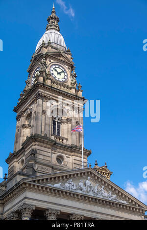 Clock tower of bolton town hall with blue sky - Stock Photo