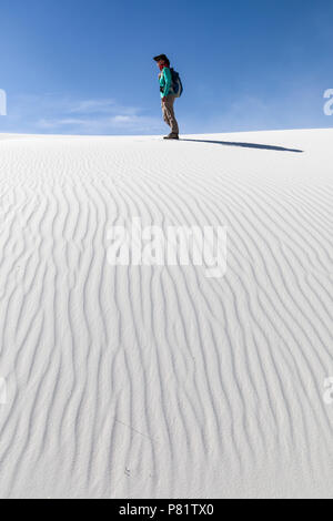 Walker on dume at White Sands, New Mexico, USA - Stock Photo
