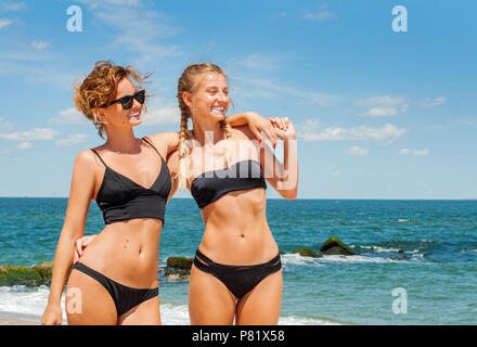 Happiness moment. Two Attractive women in bikini on the beach. Best friends having fun, summer vacation holiday lifestyle. - Stock Photo