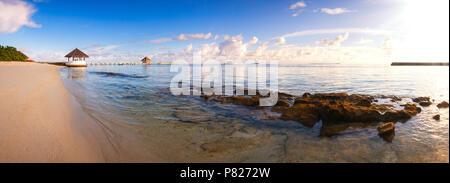 Beautiful sunset over ocean island maldives long panorama - Stock Photo