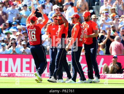 England's Chris Jordan celebrates with David Willey and Eoin Morgan after catching KL Rahul during the Second Vitality IT20 Series Match at the Brightside Ground, Bristol. - Stock Photo