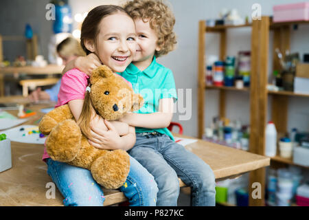 Cute Siblings Kissing - Stock Photo