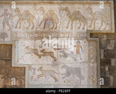 Syria. Bosra (Busra al-Sham). Daraa District. Roman mosaic, 6th century, discovered in the Theatre. Scene of camel caravan and hunting (dogs chasing hare). - Stock Photo
