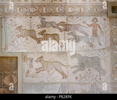 Syria. Bosra (Busra al-Sham). Daraa District. Roman mosaic, 6th century, discovered in the Theatre. Scene of hunting (dogs chasing hare). - Stock Photo