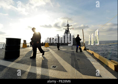 BLACK SEA (Dec. 8, 2015) Sailors conduct small-arms weapons training aboard USS Ross (DDG 71) while operating in the Black Sea Dec. 8, 2015. Ross, an Arleigh Burke-class guided-missile destroyer, forward deployed to Rota, Spain, is conducting a routine patrol in the U.S. 6th Fleet area of operations in support of U.S. national security interests in Europe. - Stock Photo