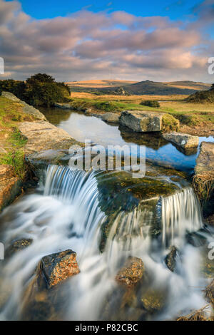 A waterfall on the Devonport Leat captured at Windy Post in the Dartmoor National Park. - Stock Photo
