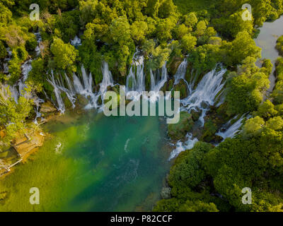Kravica Waterfall is a large tufa cascade on the Trebižat River, in Bosnia and Herzegovina. Its height is about 25 metres. - Stock Photo