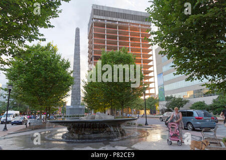 ASHEVILLE, NORTH CAROLINA, USA - JUNE 9, 2017: The Vance Monument and fountain in Pack Square round sunset in the heart of downtown Asheville, NC - Stock Photo