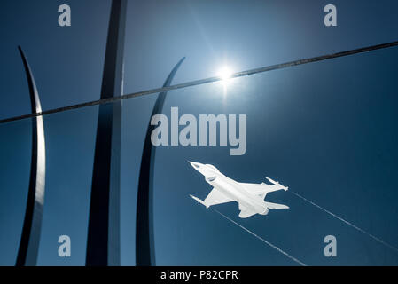 ARLINGTON, Virginia, USA - An F-16 Fighting Falcon etched into a glass panel at the US Air Force Memorial in Arlington, VA. In the background are the main spires of the memorial that are intepretations of the US Air Force Thunderbirds signature bomb burst maneuver. - Stock Photo