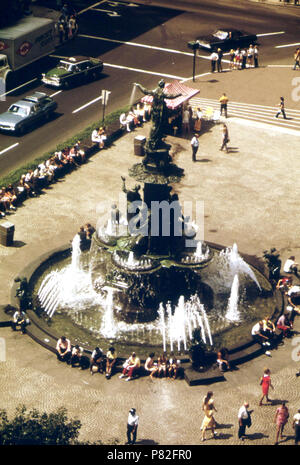 Tyler Davidson Fountain in Fountain Square. Truck Is on Fifth Street. Intersecting Street Is Vine 08 1973 - Stock Photo