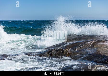 Waves splashing against the rocky shores of Jomfruland, Norway. - Stock Photo