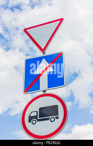 give way, Yield Sign, the passage is forbidden for trucks, the end of one-way traffic road signs - Stock Photo
