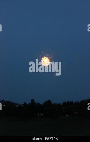 Fireworks display on the fourth of July in Glenview, Illinois. - Stock Photo