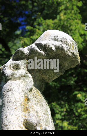 Grieving Angel stone statue at the Bohemian National Cemetery in Chicago, Illinois on a beautiful summer day. - Stock Photo