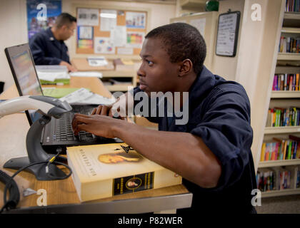 PACIFIC OCEAN (July 20, 2016) – Seaman Deion Thompson registers a library book into the ship's library system aboard amphibious transport dock ship USS Somerset (LPD 25). Somerset is participating in PHIBRON-MEU Integrated Training (PMINT), a scenario-based amphibious integration exercise with Amphibious Squadron Five and the 11th Marine Expeditionary Unit as part of the Makin Island Amphibious Ready Group (MKIARG).