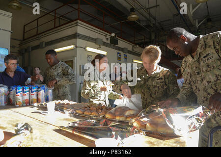 Italy (Sept. 23, 2016) – Seabees, Department of Defense Civilian personnel and host nationals assigned to Naval Support Activity (NSA) Naples Public Works Department (PWD) enjoy some refreshments as part of PWD Naples Suicide Prevention Month event.  September is Suicide Prevention Month. This year the Navy's Every Sailor, Every Day campaign is focusing on Small ACTs that Sailors, families and members of the Navy community can practice to be there for themselves and others. - Stock Photo