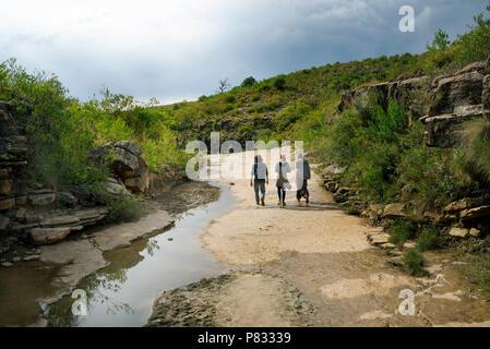 Young visitors exploring Torotoro National Park, Bolivia. - Stock Photo