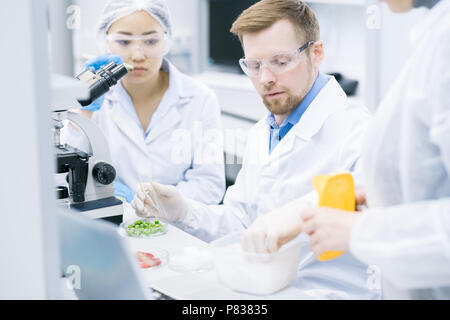 Team of Scientists Doing Research in Laboratory - Stock Photo
