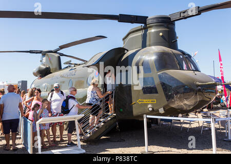 Southport, Lancashire. 8th July 2018. Sunday at the Southport Airshow 2018. The British armed forces recruitment and public relations stands attracted the interest of visitors to the Southport Airshow 2018, including visitors queuing to be shown the RAF Boeing Chinook tandem rotor helicopter. - Stock Photo