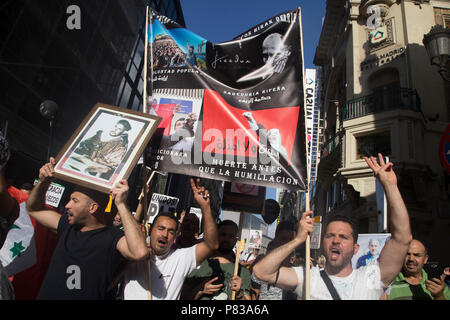Protesters seen shouting while holding posters during the protest. Members of the Hirak in Madrid protest demanding the release of the political prisoners of the Rife who were caught during the revolts of 2017. - Stock Photo